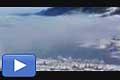 12033 - Vidéo - La dance du brouillard sur le village de Lungern et le lac de Lungerer en Suisse