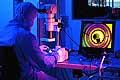 12797 - Laboratoire de lentilles de contact labo ophtalmologie - Science Lab using a Microscope Lab technician in clean suit
